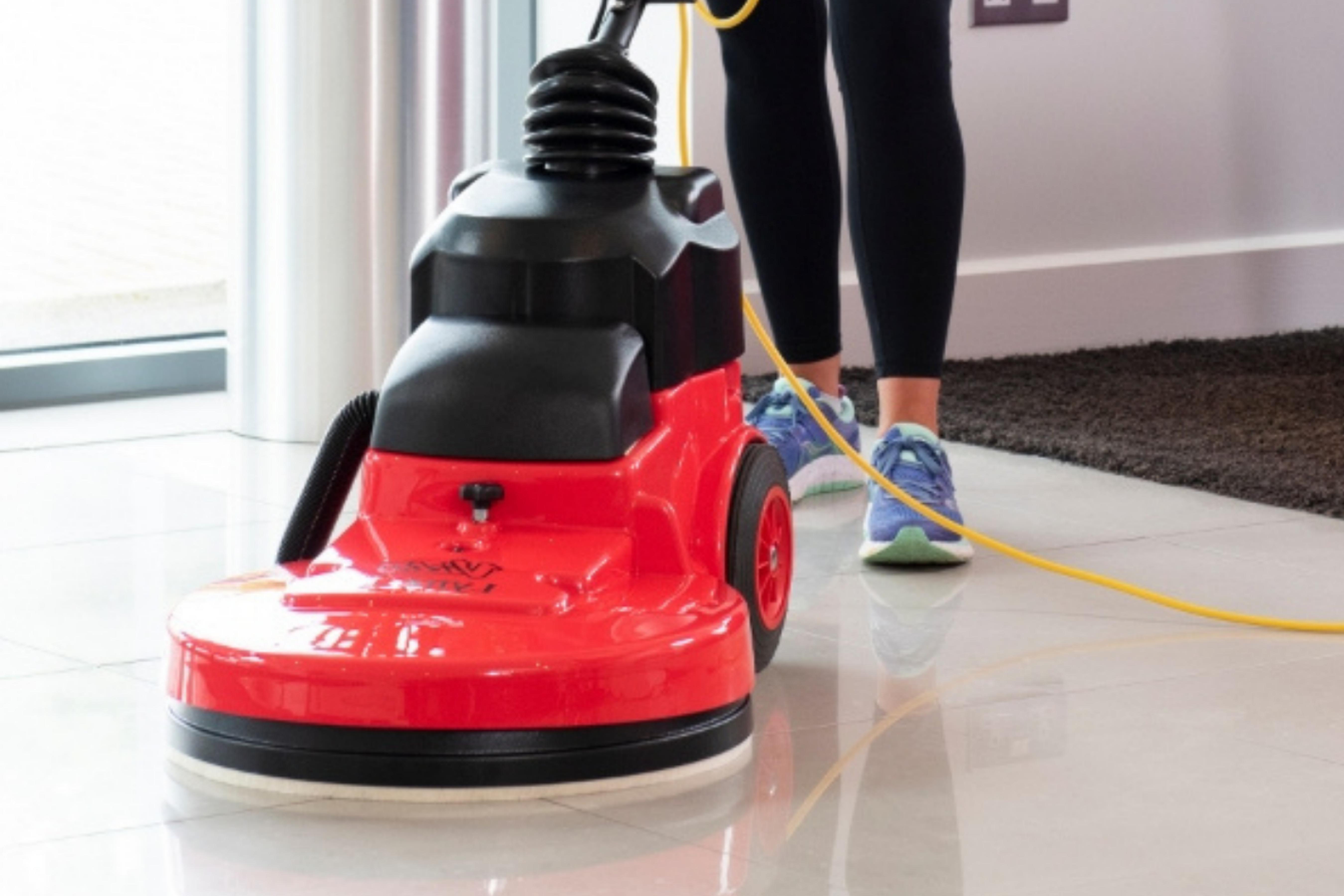 Women polishing the floor with a Victor Lynx High Speed Burnishing Machine
